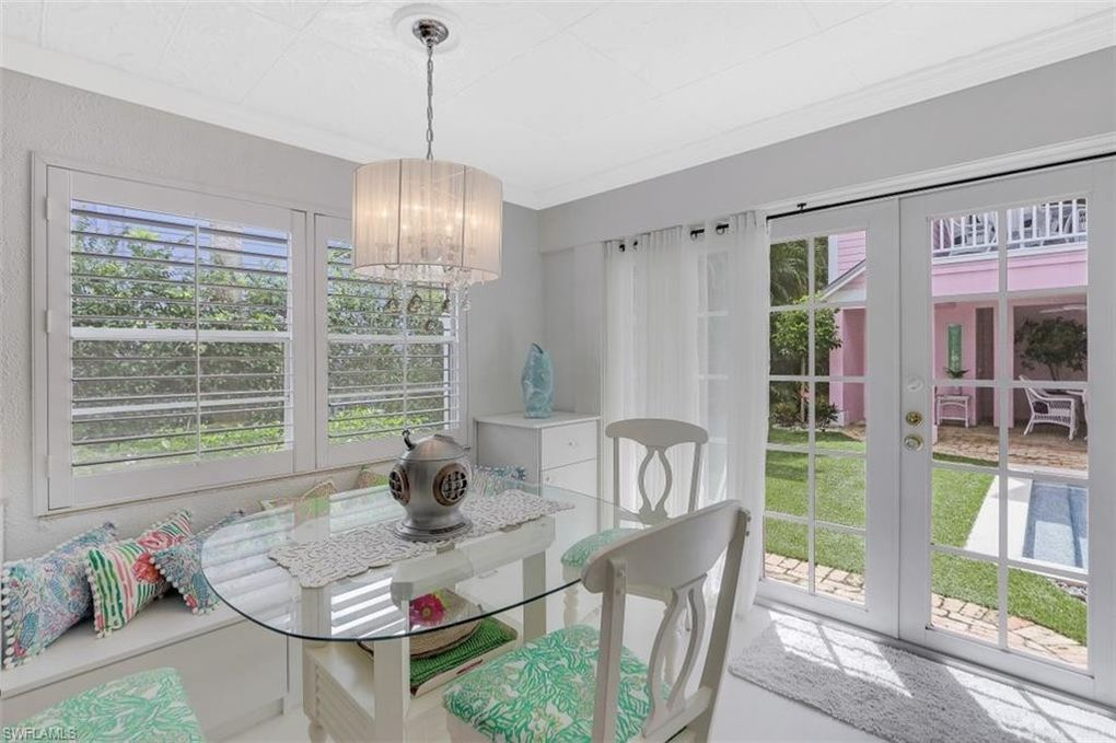 Old Florida Flamingo Style Cottage in Naples FL For sale. Eat-in kitchen,