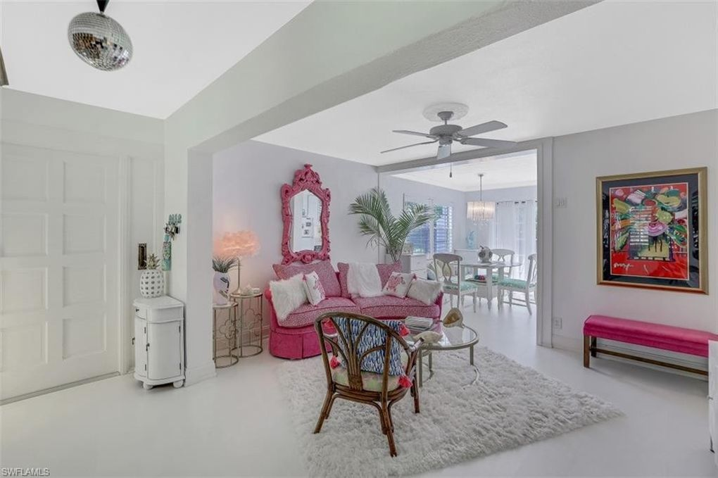 Old Florida Flamingo Style Cottage in Naples FL For sale. Living room.