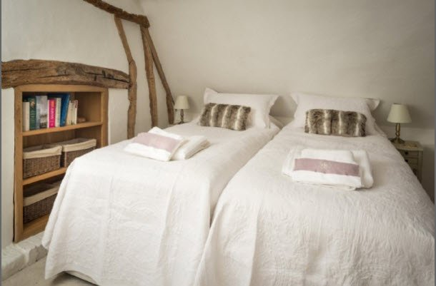 One of the bedrooms in Storybook Faerie Door Cottage to rent
