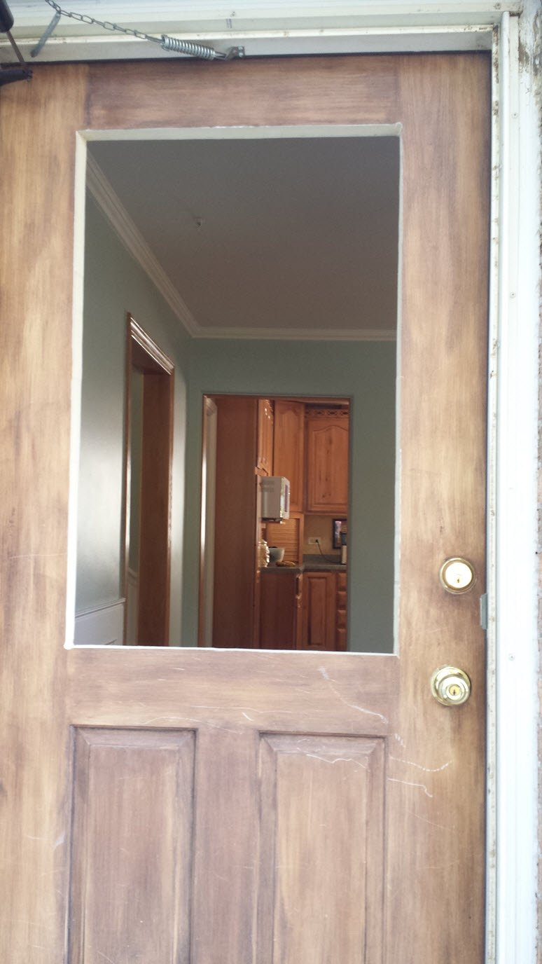 Opening to insert decorative glass window into a door for home improvement - Housekaboodle