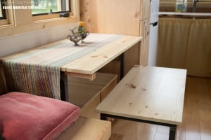 Pequod is a tiny house with nested dining table, bench and ottoman