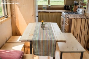 Pequod is a tiny house with custom built movable dining table, bench and ottoman
