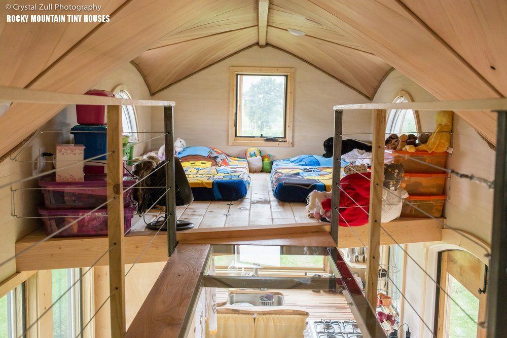 Whimsical pequod tiny house fits family of four for Tiny house designs and prices