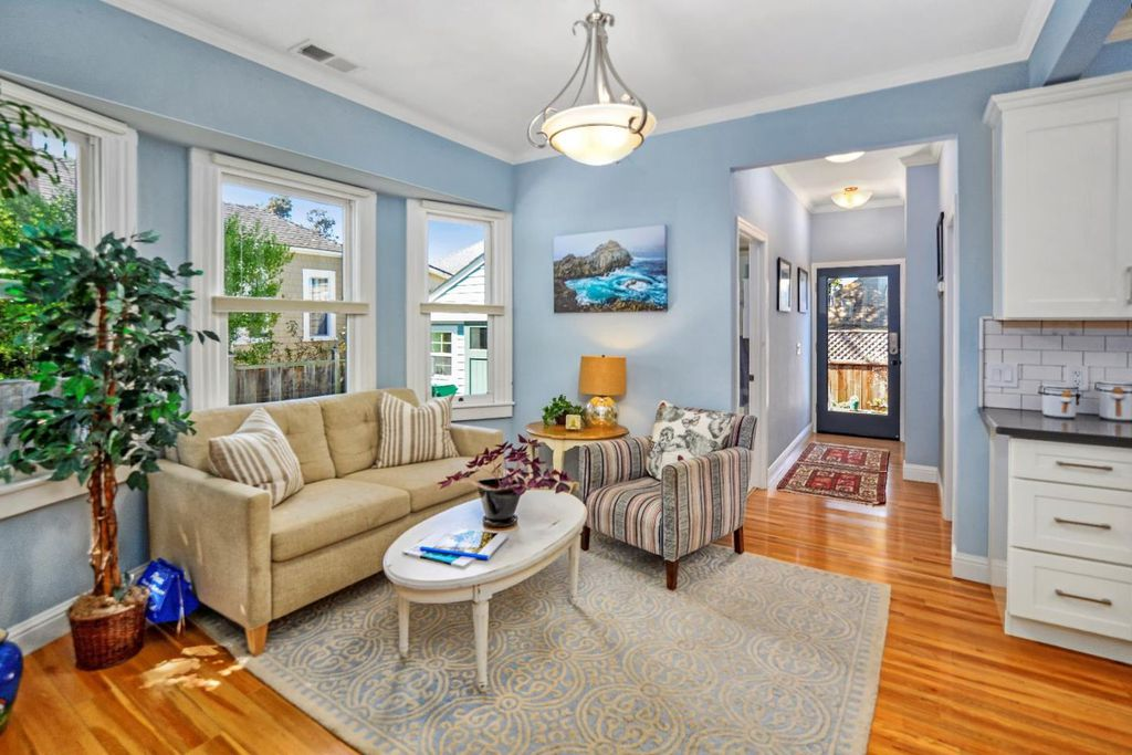 Perfect Tiny coastal cottage in Pacific Grove CA living room with bay window views