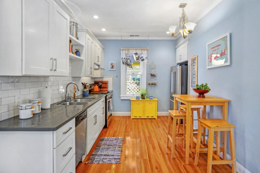 Perfect Tiny coastal cottage in Pacific Grove CA - white kitchen cabinets and hardwood floors