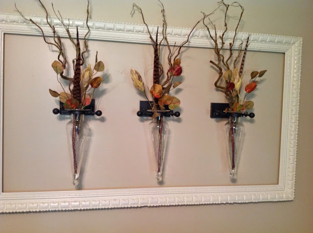 Pheasant feathers, branches and faux flower pod wall decor by Renaissance Mermaid