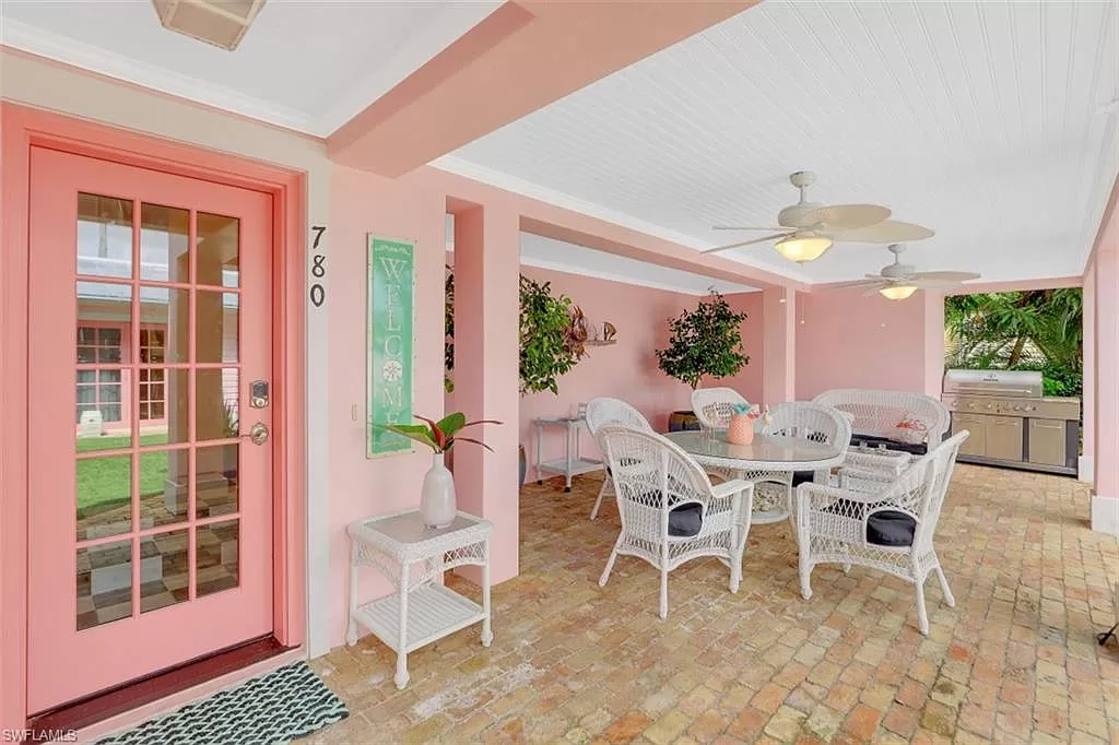 Covered lanai - Old Florida Style Cottage in Naples for sale.
