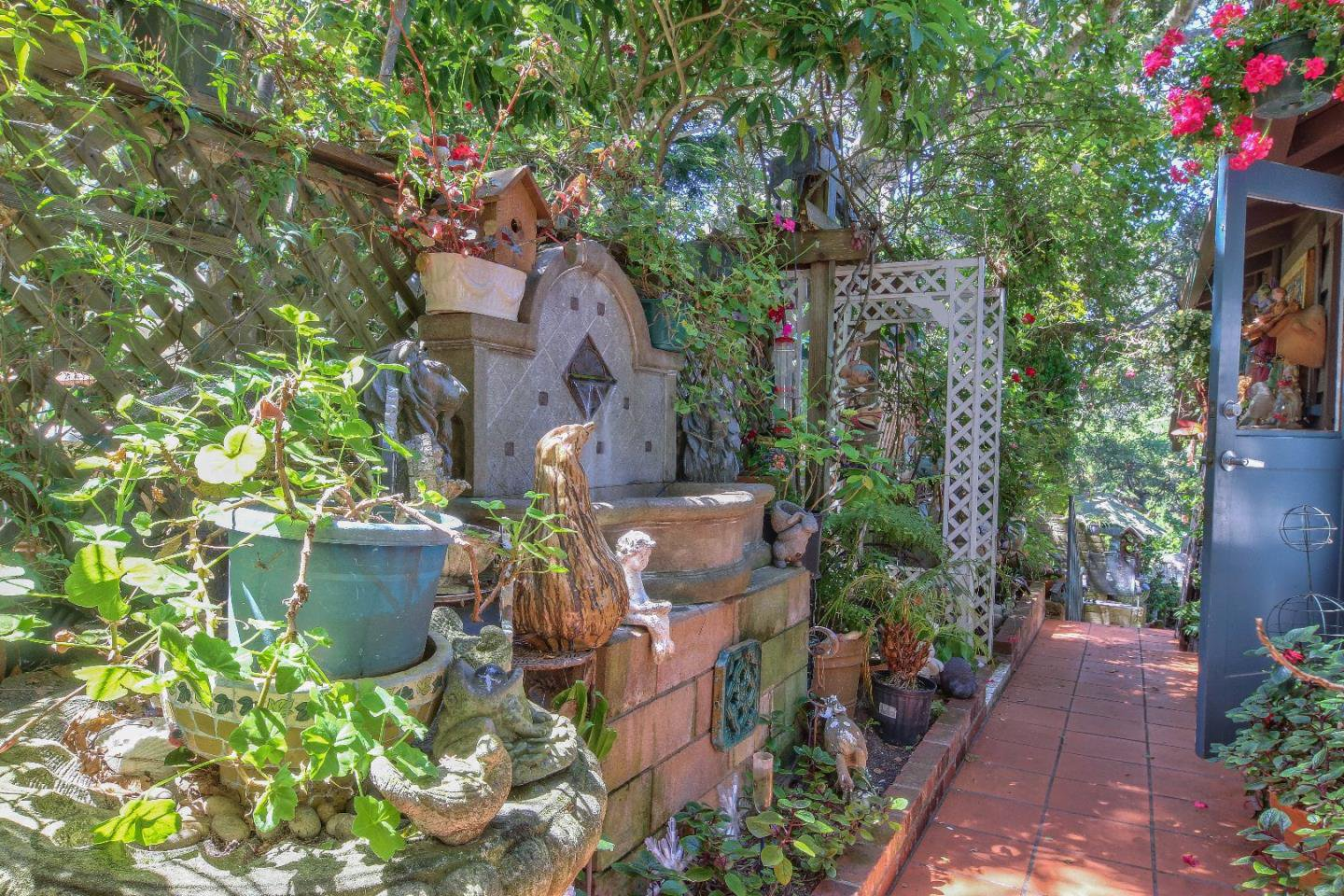 Enchanting walkway and plants adorn the property.