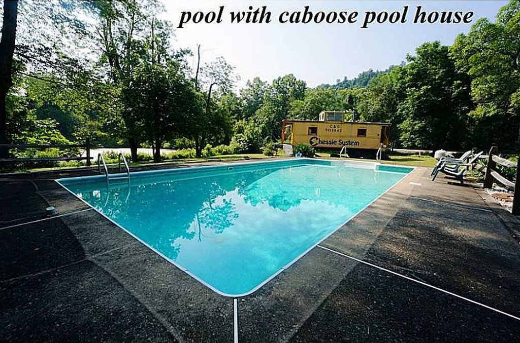 Pool with whimsical Caboose house Silence of the Lamb home for sale in PA