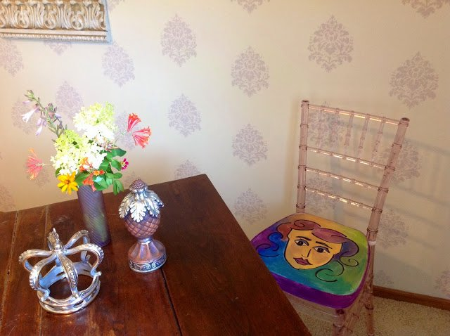 Pop art seat cushion hand painted by Julie of Renaissance Mermaid. Plus the walls are hand stenciled.