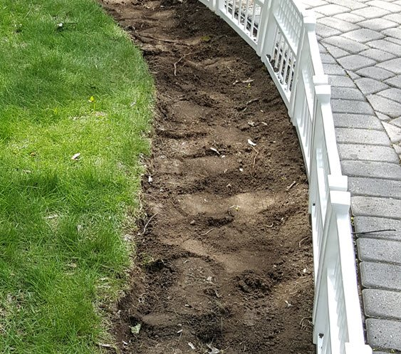 Prepare the ground by rototilling first then add top soil - curb appeal idea with a charming little white fence