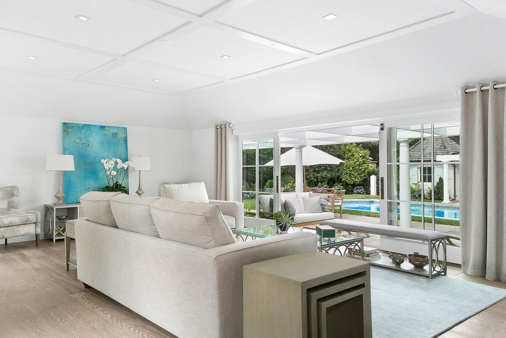 Rachel Ray house for sale at 234 Tuckahoe Ln Southampton NY - living room overlooking pool