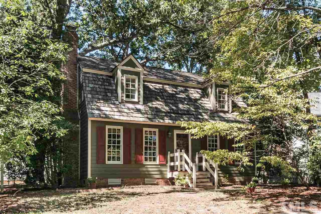 Charming Cottage in Raleigh North Carolina. I fell in love with the exterior immediately. Love the dormers, siding, shutters and .........everything!