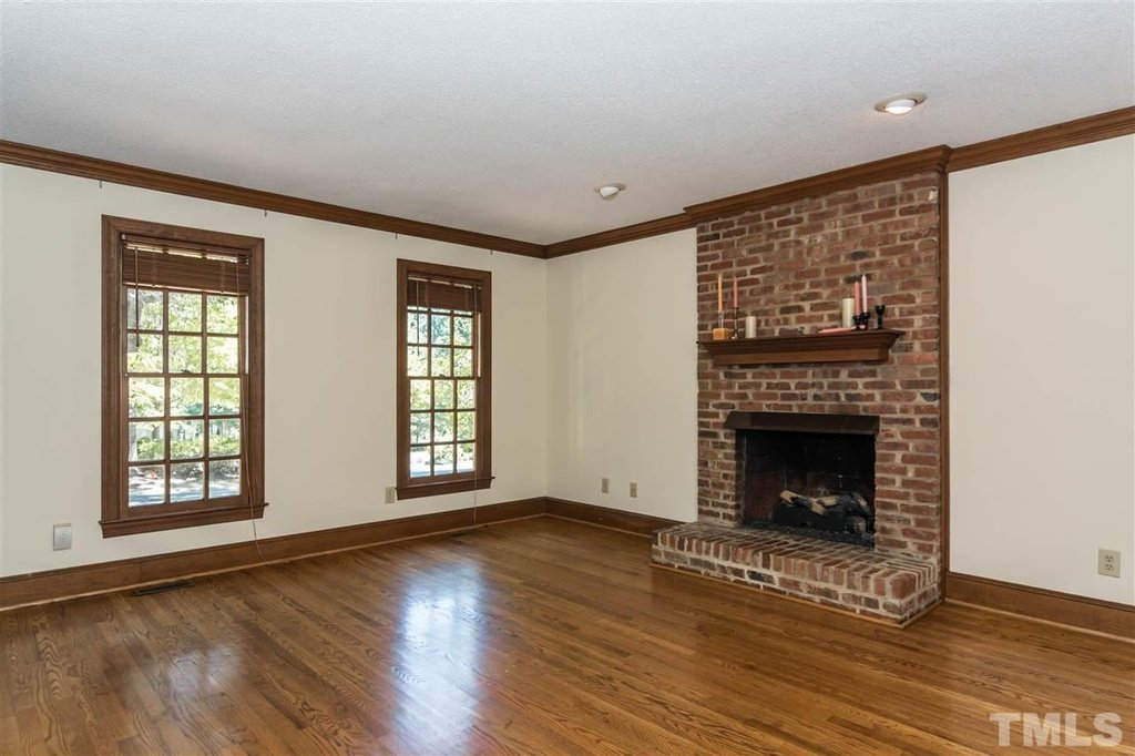 Cottge Raleigh North Carolina 3 bedrooms and 2 bath charming cottage. Warm wood floors and cottage windows and kind of perfect brick fireplace that goes with the exterior of the home.