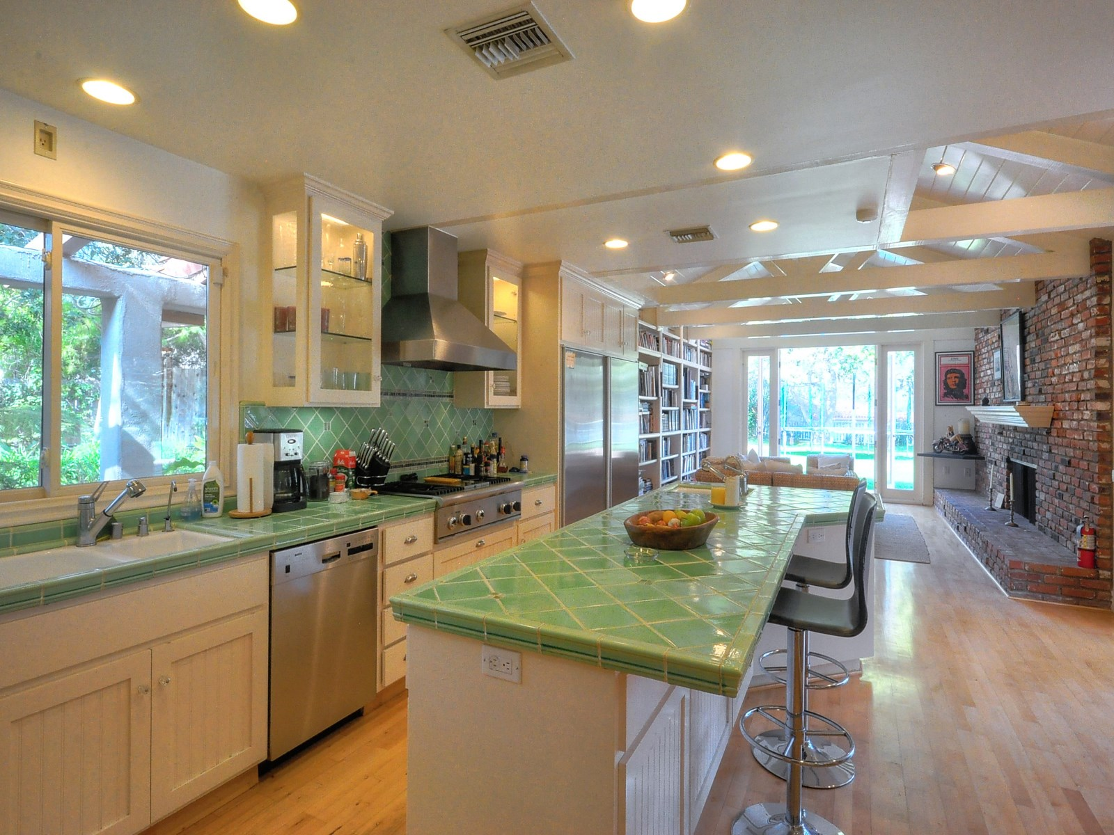 Refreshing green countertops and beadboard cabinets - Sean Penn Malibu home -sothebyshomes