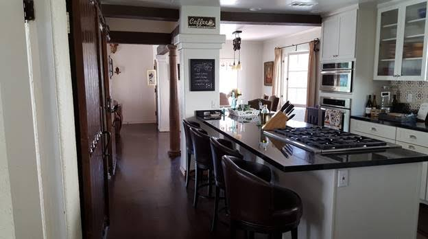 Remodeld kitchen with black countertops and island
