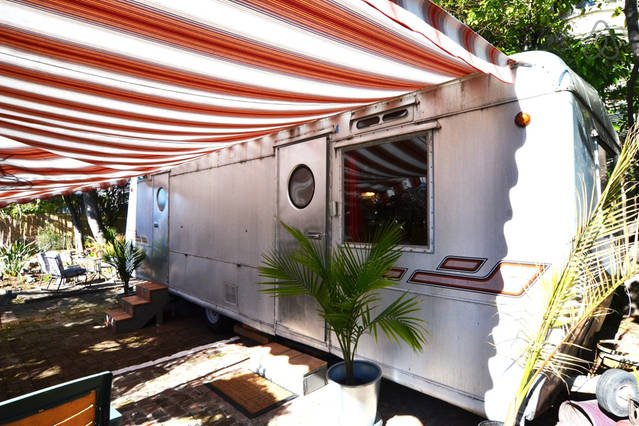 Travel Trailer is a 1954 Prairie Schooner Camper