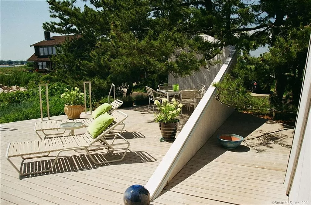 Deck for Triangular shaped home for sale in Guilford CT.