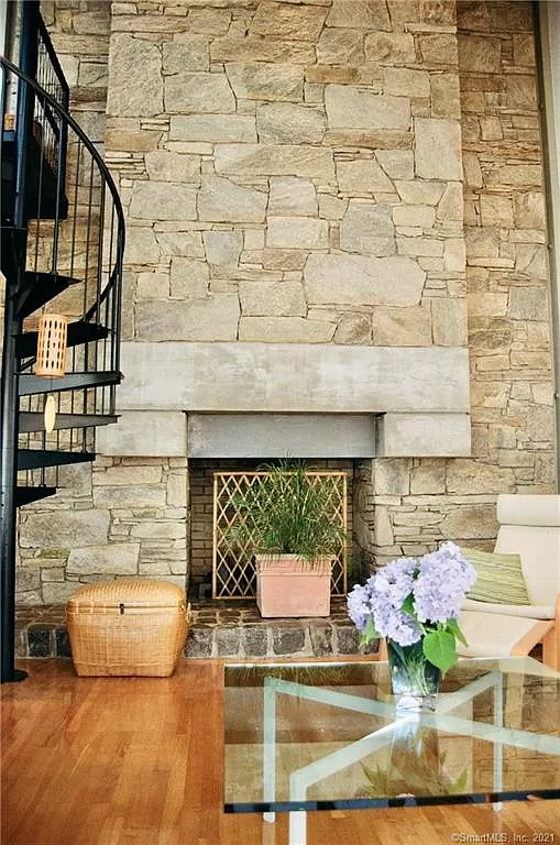 Sailboat House in CT for sale also has a towering stone fireplace.