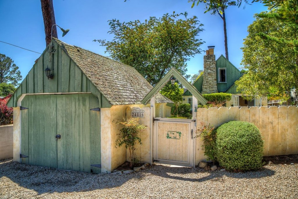 So magical! This house in Carmel California is a Comstock Fairytale Cottage - I am enchanted with the wooden gate that bears the name The Ivy on the door