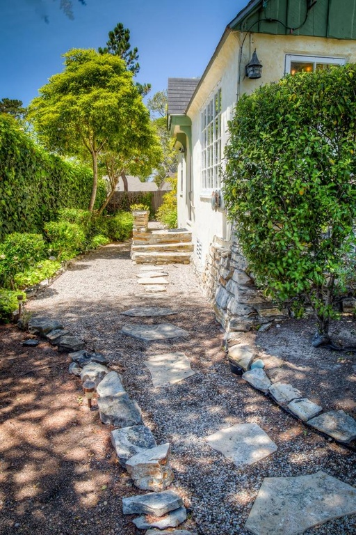 Stone path entrances are part of the charm of this house for sale in Carmel CA