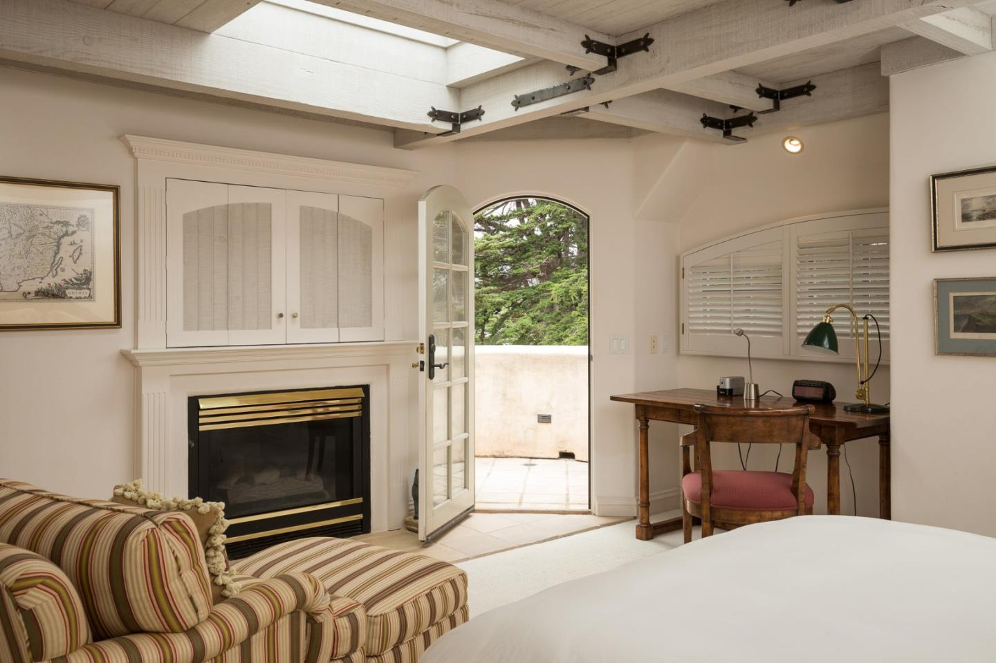 Storybook cottage in Carmel Ca for sale - Bedroom with balcony and fireplace