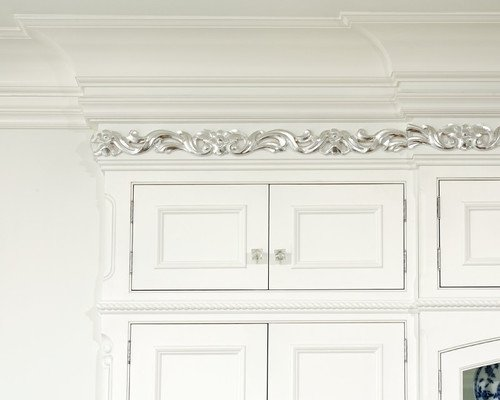 Surprising silver painted trim on elegant white kitchen cabinets. This kitchen is called French Vanilla