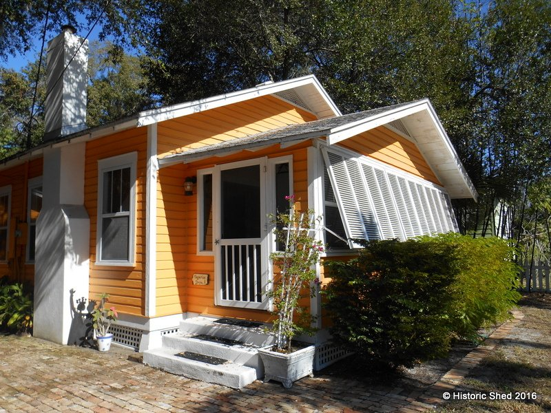 A Tangerine Carriage House Designed by Historic Shed