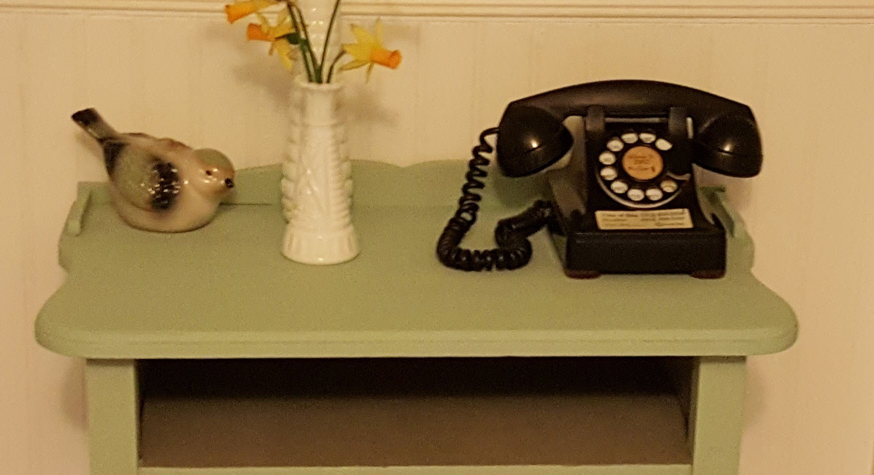 Telephone table with old phone is an antique table now painted in beautiful blue
