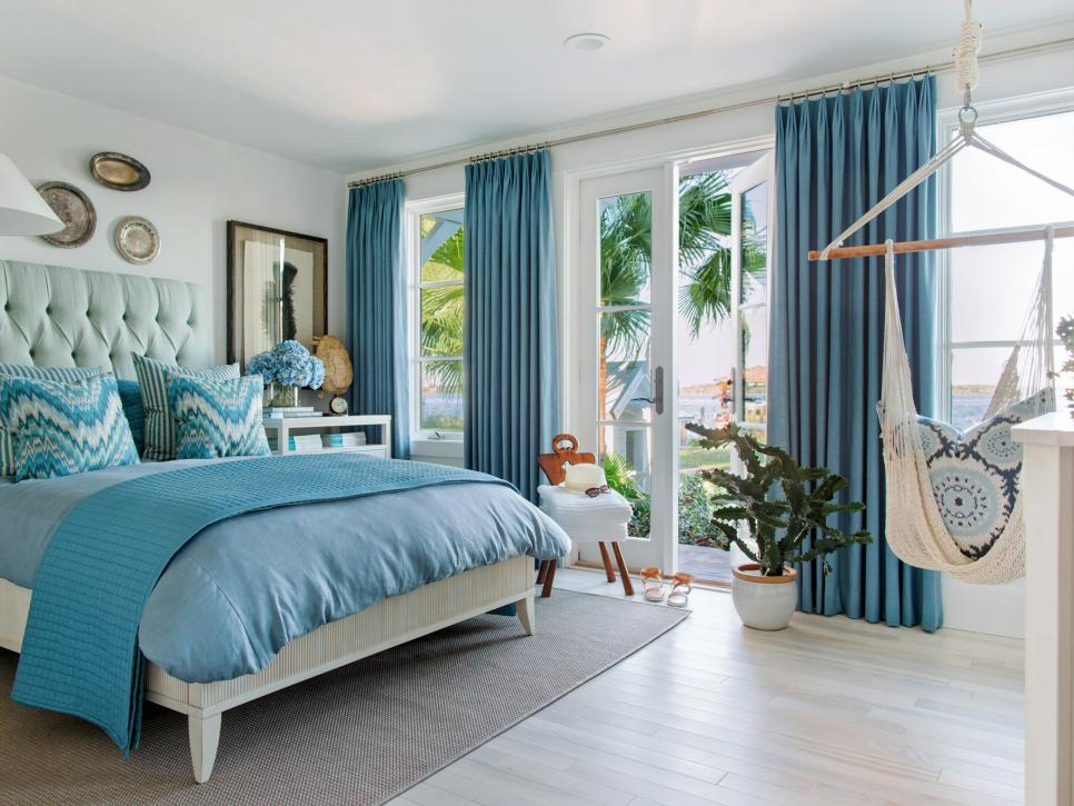 Terrace suite bedroom is done in dreamy coastal blues that is just perfect for this beach house