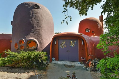 The Flintstone House for sale has a whimsical purple door - 45 Berryessa Way Hillsborough CA curbed sf