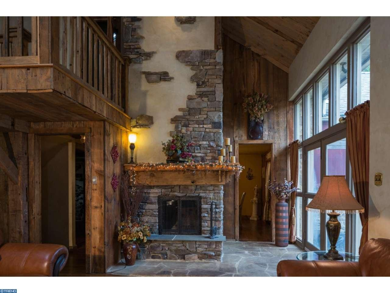 The Leap Year Barn 115 Arrons Ave Doylestown PA for sale - living room with stone storybook fireplace and wall of windows