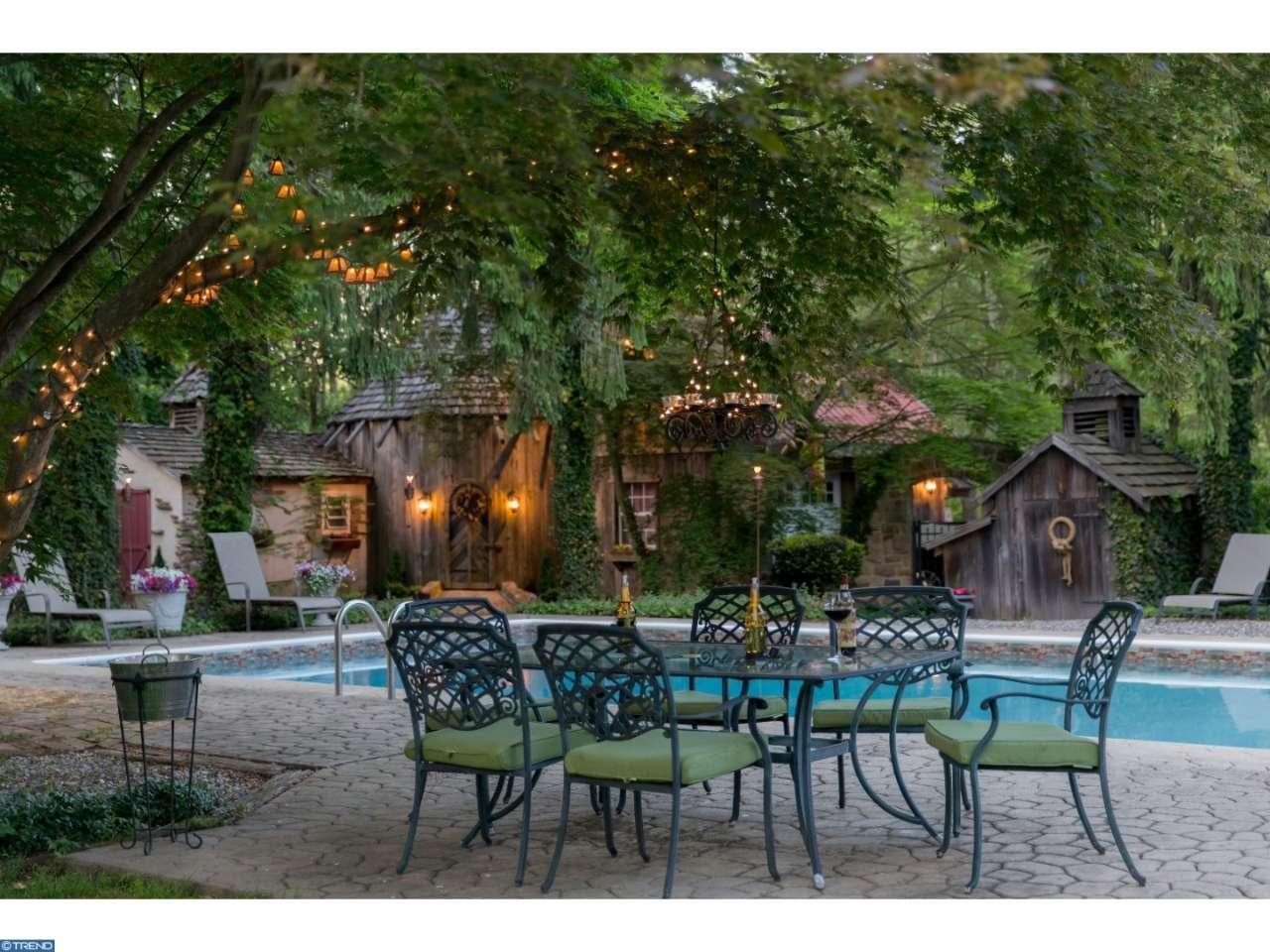 The Leap Year Barn house has a storybook setting. I especially like the setting here around the pool
