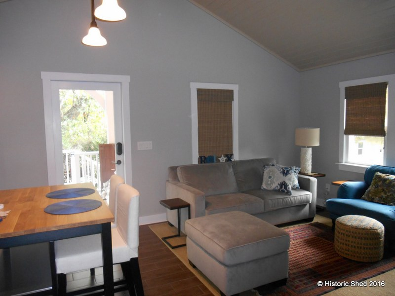 The living room inside Tangerine Carriage House in Florida for rent
