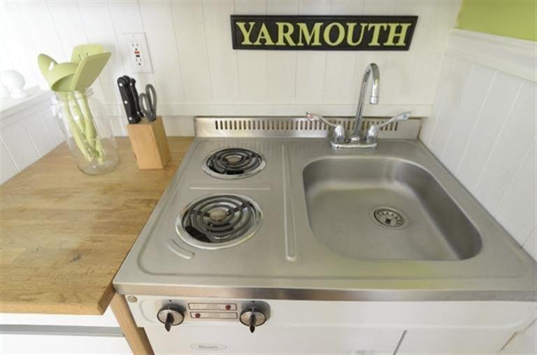 This might be the tinest kitchen sink and cooktop of them all - Cape Cod Cottage in MA