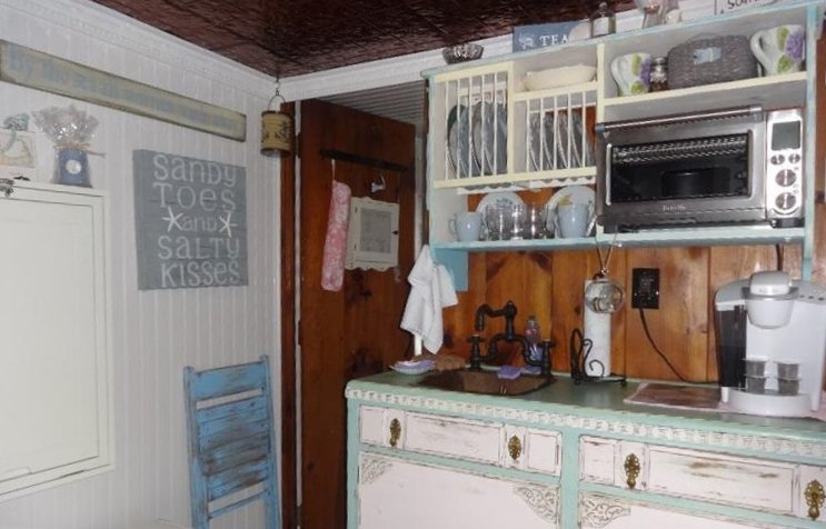 Tiny Yarmouth MA cape cod cottage for sale has an updated Euro Kitchen