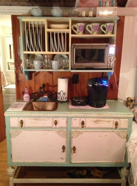 Tiny Yarmouth MA cape cod cottage for sale has this awesome shabby chick Euro-style kitchen