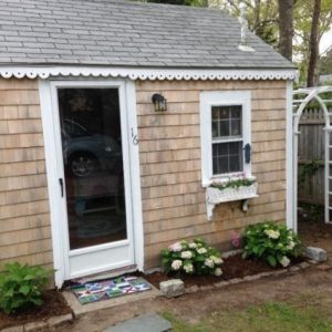 Tiny Yarmouth MA beach cottage for sale is the most adorable