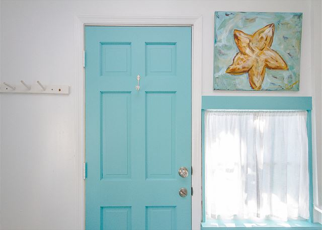 Turquoise interior door inside Old Love Cottage