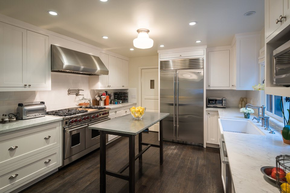 Updated kitchen has Carrera marble, stainless steel appliances