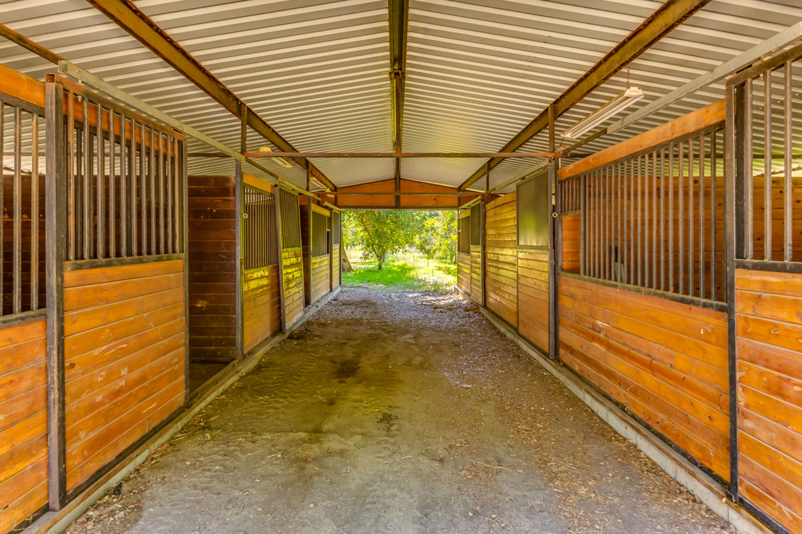 Valley Center CA adobe home for sale includes this 5 stall cedar horse stable