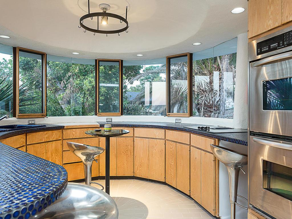 Kitchen in unusual house shaped like a sand dollar for sale in Lakeway Texas
