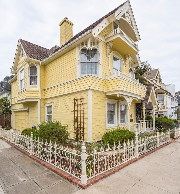 Victorian Yellow House The Daffodil for sale in Pacific Grove CA is on a corner lot.