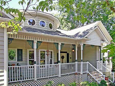Victorian style cottage is one story and has all the authentic Victorian eye candy.