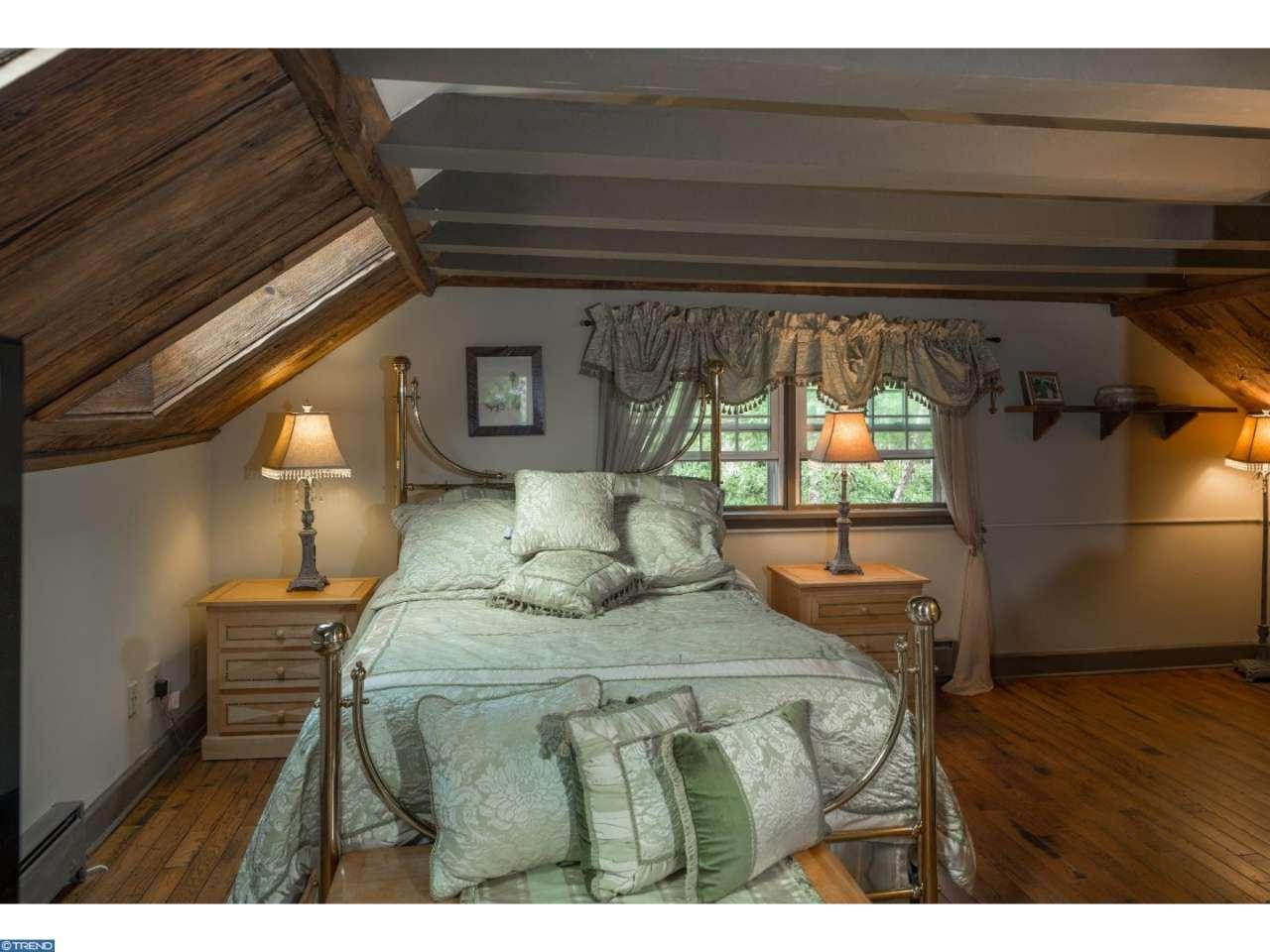Warm and cozy bedroom in Leap Year Barn house for sale in Doylestown PA
