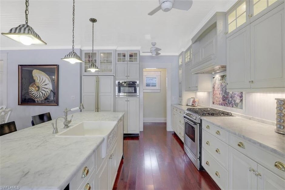 White kitchen in this Naples Florida house for sale 780 9th St