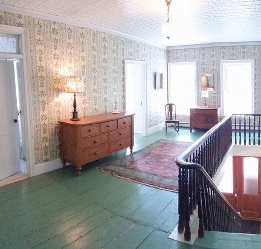 Wide plank painted floors inside historic Catalpa House