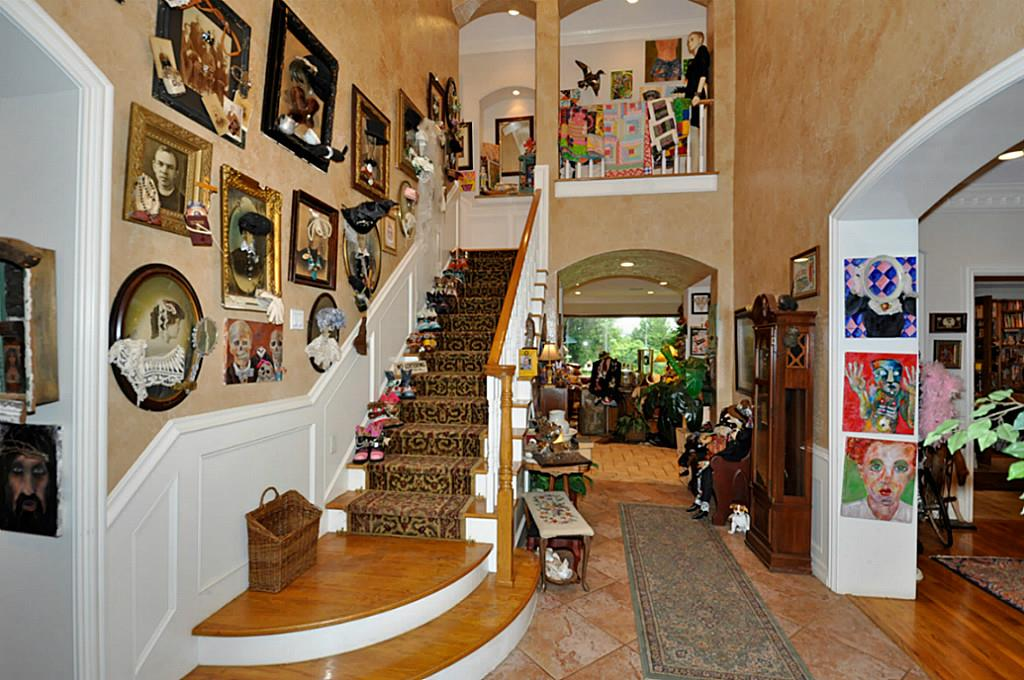 Most unusual real estate listing home decor - The entry shows the staircase and arched entryway to the right