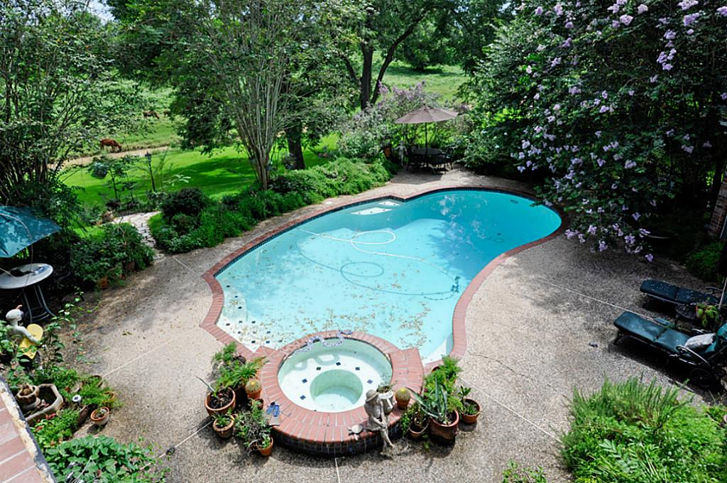 The house comes with this fancy shaped pool. A lovely home looking for love for sale in Richmond Texas